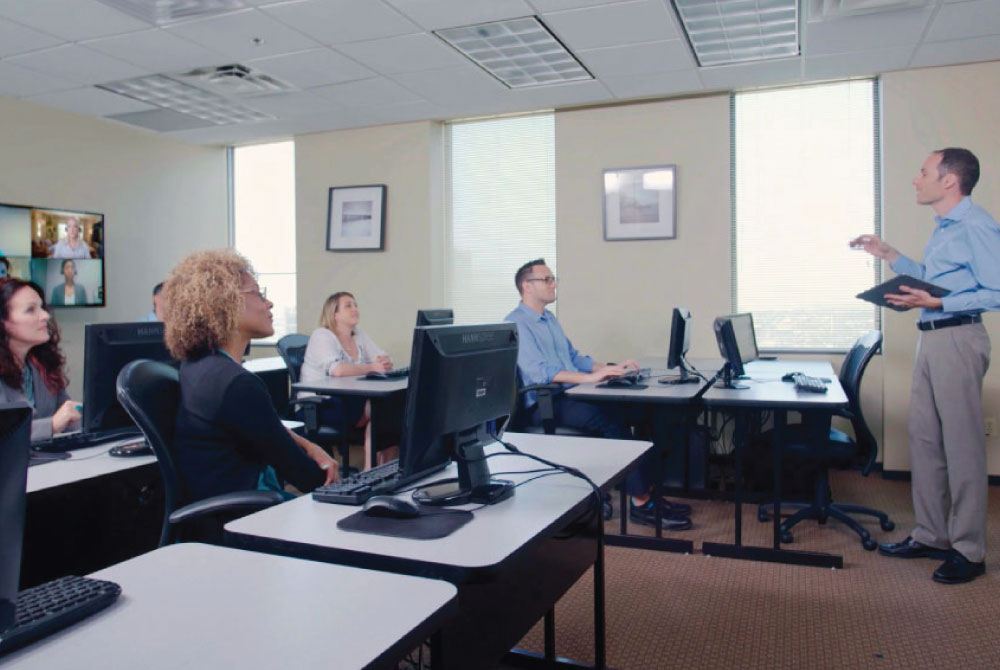 IT instructor teaching private group training at ExitCertified